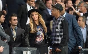 Beyoncé et Jay-Z au Parc des Princes lors de la victoire du PSG contre Barcelone en Ligue des champions le 30 septembre 2014.