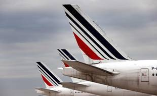 A photograph taken on November 25, 2020 shows Air France planes parked in Roissy airport, northern Paris. (Photo by Thomas COEX / AFP)