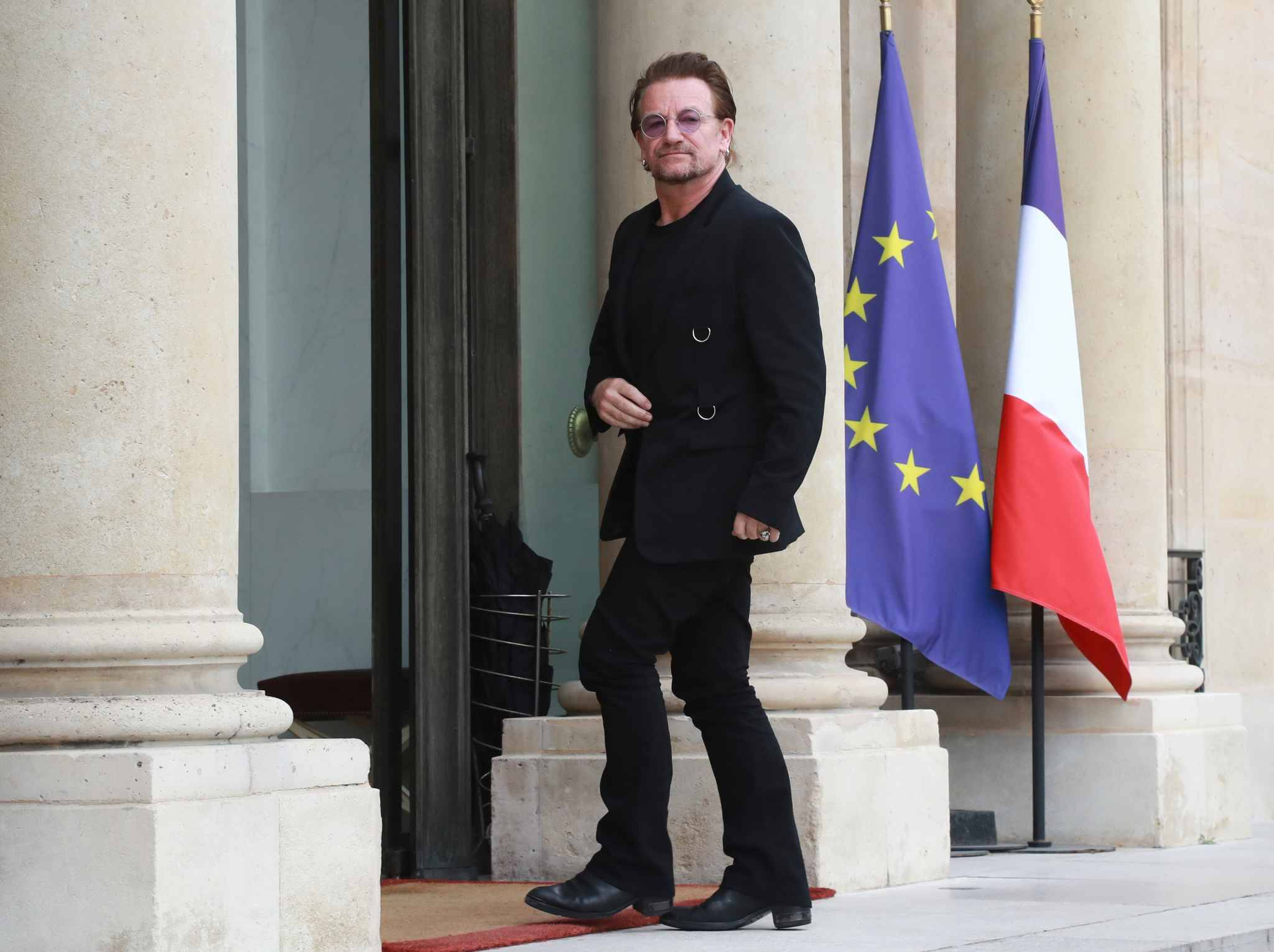 Irish U2 musician and philanthropist Bono, co-founder of the organisation ONE, arrives at the Elysee Palace in Paris  to meet with the French president on July 24, 2017.  Paul David Hewson, better known as Bono, will be meeting the French president in a bid to champion his organisation One which battles against extreme poverty and illness, particularly in Africa.
