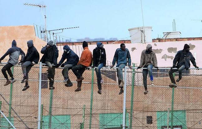 648x415 migrants tentent passer frontiere separant maroc espagne melilla 19 fevrier 2015