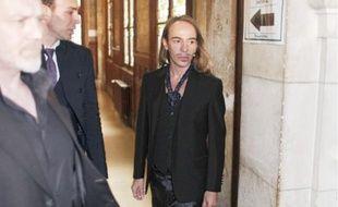 John Galliano à son arrivée au Palais de Justice de Paris, hier.