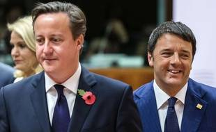 British Prime Minister David Cameron, center, and Italian Prime Minister Matteo Renzi, right, arrive for a round table meeting at an EU summit in Brussels on Friday, Oct. 24, 2014. Britain says its prime minister, David Cameron, is protesting a European Union request for an additional 2.1 billion euro ($2.65 billion) contribution to the EU coffers at a time of increasing pressure at home for the country to leave the bloc. (AP Photo/Geert Vanden Wijngaert)/VLM110/980972096545/1410241208
