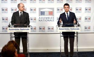 Le président du groupe PS à l'Assemblée Bruno Le Roux (à gauche) et le Premier ministre Manuel Valls le 21 septembre 2015.