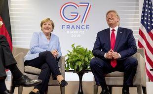 La chancelière allemande Angela Merkel et le président américain Donald Trump, lors d'une rencontre dans la cadre du G7, le 26 août 2019.