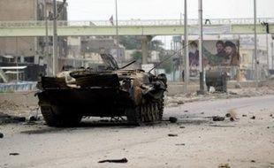 """Moqtada Sadr, qui conteste la légitimité du gouvernement Maliki, a appelé à trouver une solution """"pacifique"""" aux violences, qui se son"""