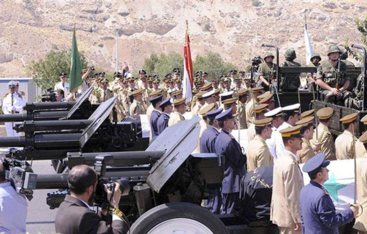 Cérémonie funéraire de trois hauts responsables du régime syrien, à Damas, le 20 juillet 2012. – REUTERS/Sana Sana