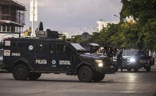 La police mexicaine à Culiacan, dans l'Etat du Sinaloa, le  17 octobre 2019, après un affrontement avec des hommes du clan de Joaquin