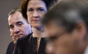 Le Premier ministre social-démocrate suédois Stefan Löfven et la représentante du parti conservateur Anna Kinberg Batra participent à une conférence de presse à Stockholm, le 27 décembre 2014