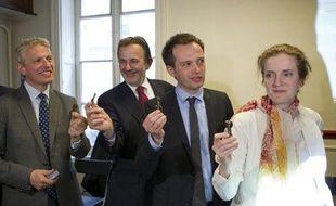 Le 29 mai 2013. Les 4 candidats a la primaire UMP, Franck Margain, Jean-Francois Legaret, Nathalie Kosciusko-Morizet et Nathalie Kosciusko-Morizet presentent la cle electronique qui est censee eviter les fraudes lors du vote.