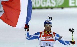 Le biathlète français Martin Fourcade, lors de la troisième place de la France en relais mixte aux championnats du monde de biathlon le 3 mars 2011 à Khanty Mansiysk, en Russie.