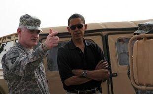 Barack Obama était dimanche au Koweït en provenance d'Afghanistan où il avait débuté la veille une tournée internationale;