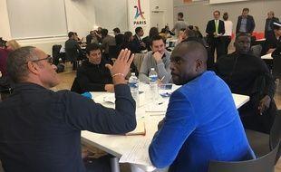 Richard Dacoury et Pascal Gentil, au premier plan, lors de la réunion des athlètes à l'Insep pour parler des JO 2024, le 8 novembre 2017.