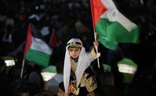 Des Palestiniens célèbrent la reconnaissance de leur Etat comme membre observateur de l'ONU par l'Assemblée Générale le 29 novembre 2012 à Ramallah