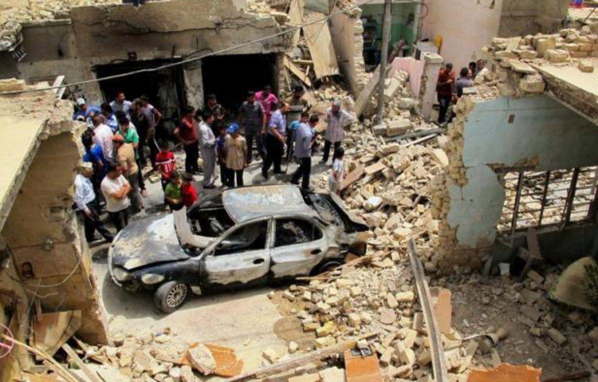 Vingt personnes ont été tuées et plus de 100 blessées jeudi dans des attentats en Irak, dernier épisode de la violence qui s'est intensifiée en juin dans ce pays en proie à une grave crise politique. – Khalil al-Murshidi afp.com