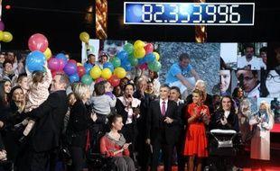Décompte final du montant des promesses de dons au 28e Téléthon, le 6 décembre 2014 à Paris.