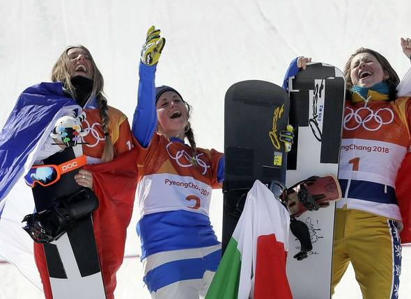 From left; Silver medal winner De Sousa Mabileau Julia Pereira, of France, gold medal winner Michela Moioli, of Italy, and bronze medal winner Eva Samkova, of the Czech Republic, celebrate after the women's snowboard finals at Phoenix Snow Park at the 2018 Winter Olympics in Pyeongchang, South Korea, Friday, Feb. 16, 2018.
