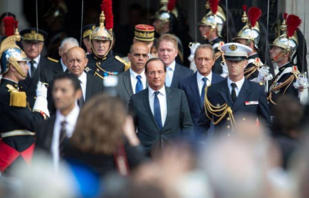 Le président François Hollande qui présidait samedi le 68ème anniversaire de la Libération de Paris sur le parvis de l'Hôtel de Ville, s'est revendiqué de l'héritage de la Résistance et de ses valeurs. – Bertrand Langlois afp.com