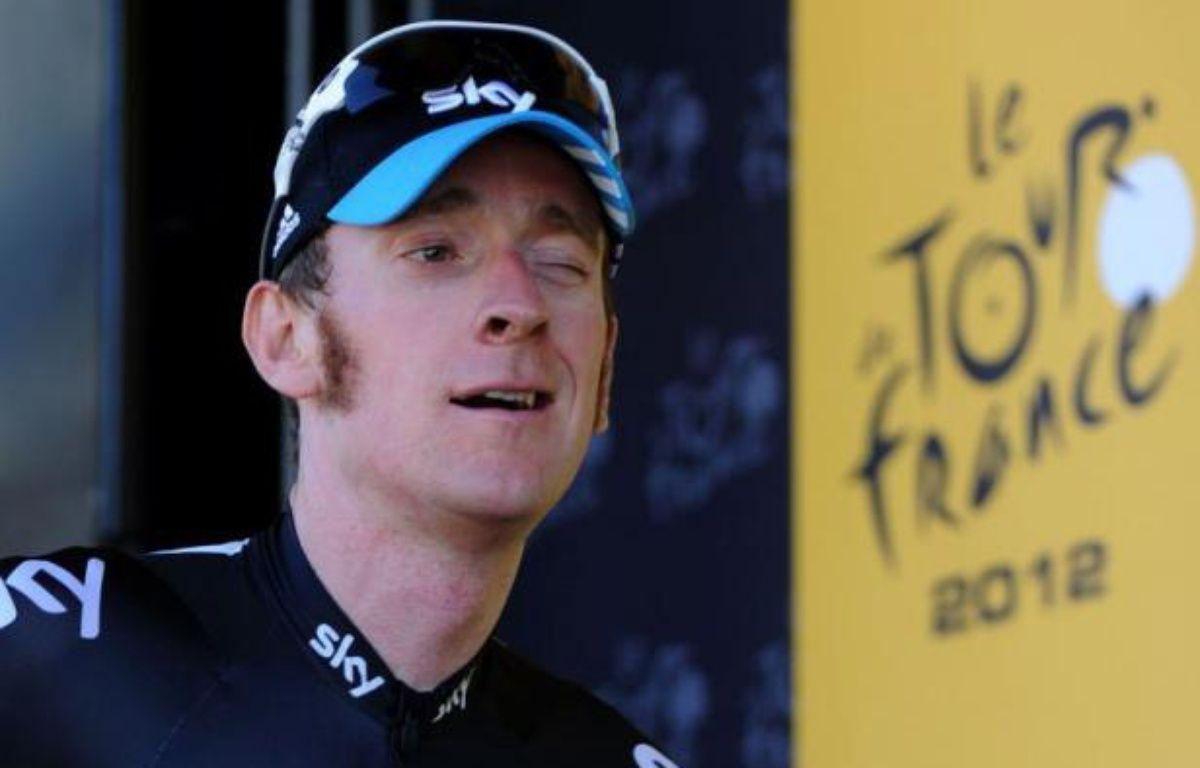 Le maillot jaune du Tour de France, Bradley Wiggins, s'est emporté dimanche après la 8e étape contre les comparaisons qui fleurissent sur les réseaux sociaux entre son équipe Sky et l'équipe US Postal de Lance Armstrong, sous-entendant du dopage. – Pascal Pavani afp.com