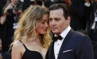 Amber Heard, left, and Johnny Depp pose for photographers upon arrival at the premiere of the film Black Mass during the 72nd edition of the Venice Film Festival in Venice, Italy, Friday, Sept. 4, 2015. The 72nd edition of the festival runs until Sept. 12.  (AP Photo/Andrew Medichini)/XDS148/236977346001/1509042052