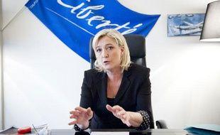 Le 28 mars 2012. Marine Le Pen, candidate du Front National à la présidentielle, en interview pour 20 Minutes dans son QG de campagne, à Paris.