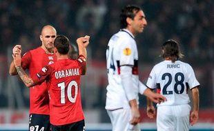 Les joueurs lillois se congratulent après leur victoire 3-0 en Ligue Europa face au Genoa, le 22 octobre 2009