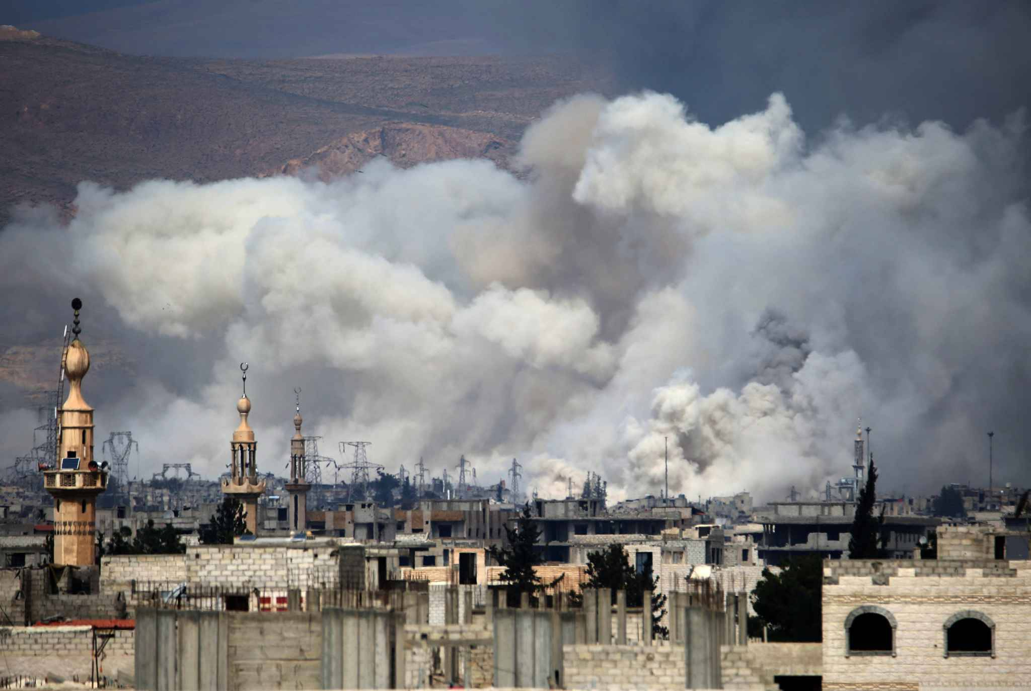 Smoke billows following reported air strikes by Syrian government forces on Damascus' north eastern rebel-held al-Qaboun surburb on March 15, 2017.