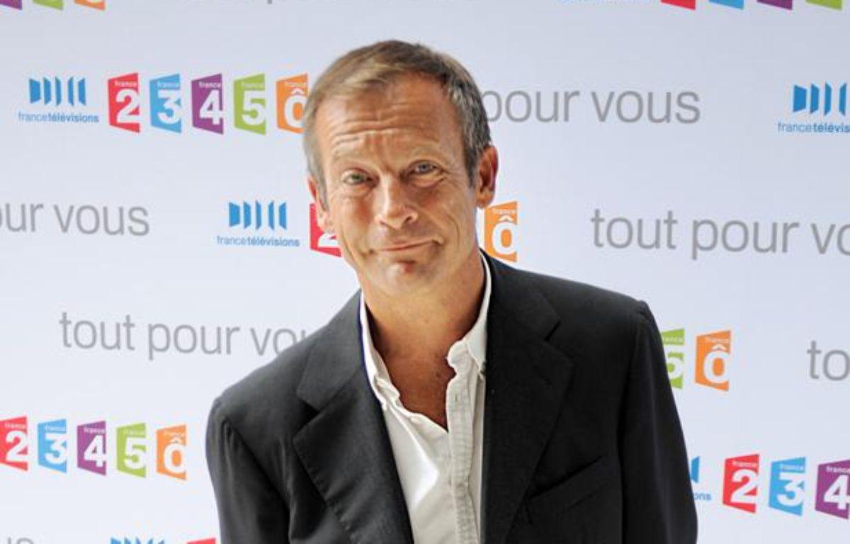 Le présentateur télé Laurent Bignolas. – MARTIN BUREAU / AFP