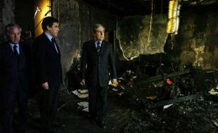 France's Prime Minister Francois Fillon (2nd L) and Ange Santini (C), speaker of the executive council of Corsican Territorial Assembly, and the speaker Camille de Rocca (L) view the remains of Santini's office after a fire was set on Saturday by Corsican nationalist militants who occupied the building, during Fillon's visit to Ajaccio January 14, 2008. REUTERS/Pierre Murati (FRANCE)