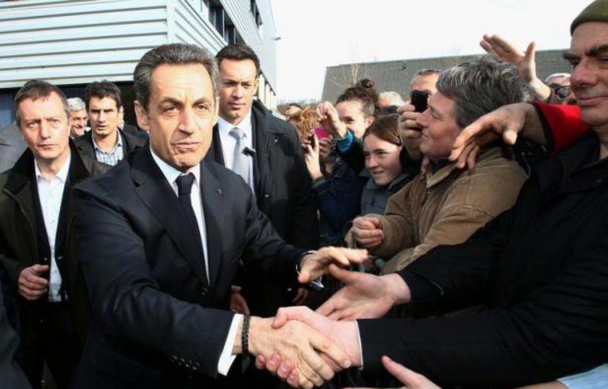 """A trois jours du premier tour de l'élection présidentielle, Nicolas Sarkozy a proposé d'attendre """"tranquillement"""" les résultats du scrutin, mercredi sur RMV/BFMTV, alors qu'il décroche dans un sondage face à son adversaire socialiste François Hollande. – David Vincent afp.com"""