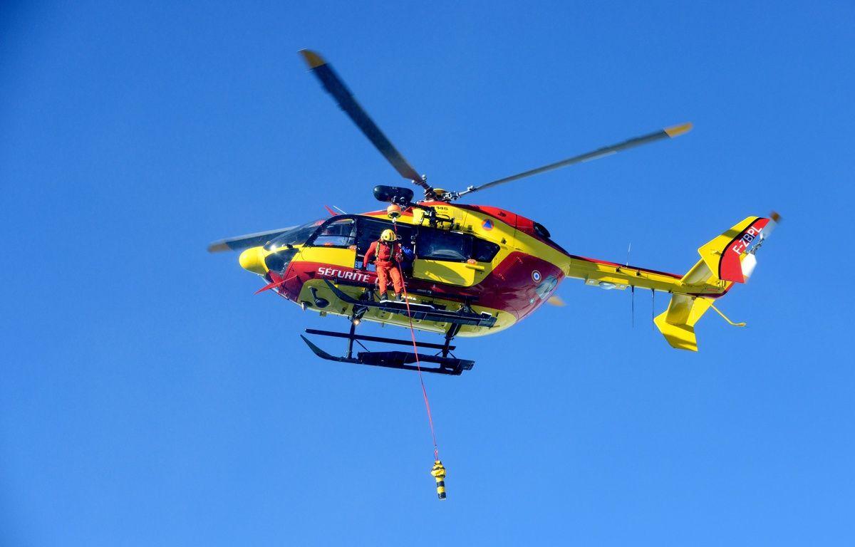 Illustration d'une intervention d'un hélicoptère de la sécurité civile – JEAN-PIERRE CLATOT / AFP