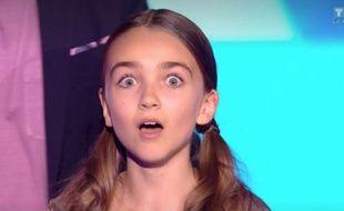 Angelina, bouche bée, à l'annonce de sa victoire à « The Voice Kids 4 ».