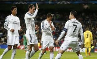 Raphaël Varane, Gareth Bale et Cristiano Ronaldo célèbrent le festival du Real contre Ludogorets (4-0), le 10 décembre 2014 à Madrid.