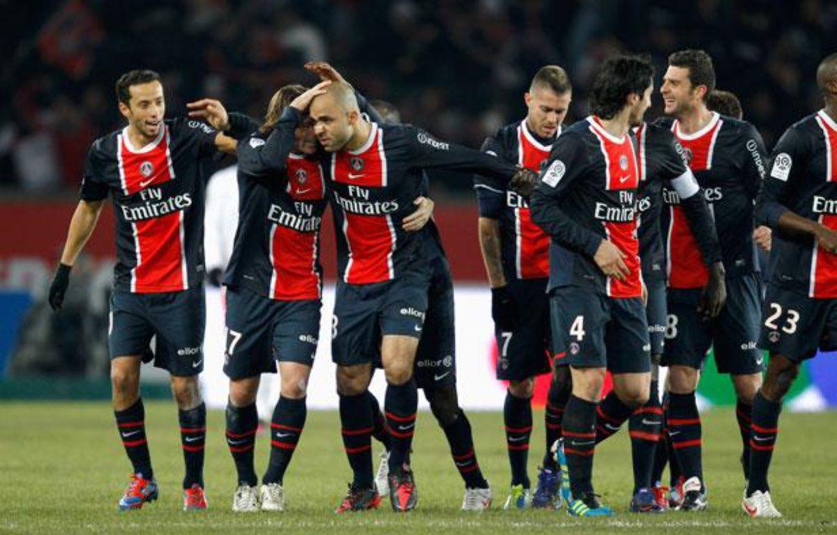 Les Parisiens se congratulent après avoir marqué au Parc des Princes contre MOntpellier le 19 février 2012. – REUTERS/Benoit Tessier