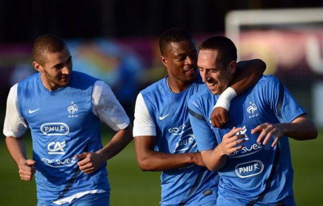 Les Français Benzema, Evra et Ribéry lors d'un entraînement le 9 juin 2012, à Kirsha.