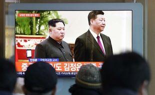 Des images de la rencontre Kim/Xi à Pékin sont diffusées à la télévision sud-coréenne, le 8 janvier 2019.