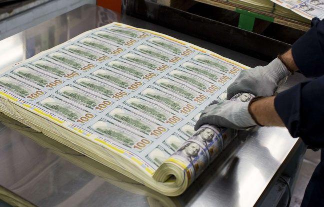 A sheet of 100 dollar bills printed at the Bureau of Engraving and Printing in Washington.