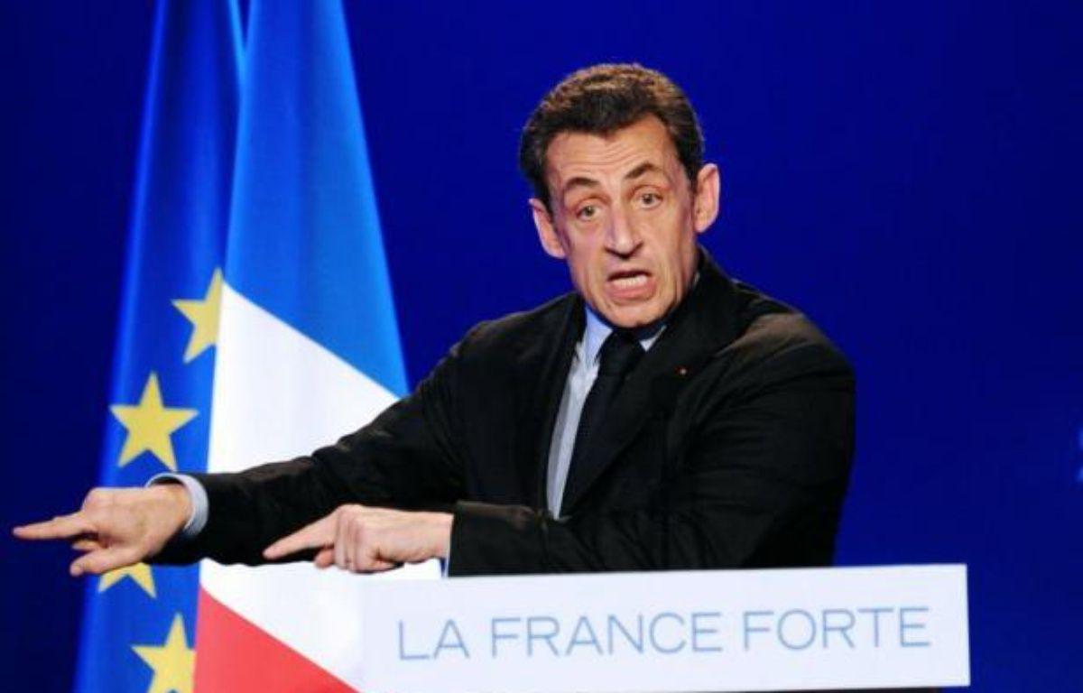 """A quatre jours du premier tour de la présidentielle, Nicolas Sarkozy a clairement appelé les électeurs du Front national à voter pour lui, les mettant en garde contre """"les mensonges"""" des partis extrémistes qui ne peuvent pas apporter de solution à leur souffrance. – Denis Charlet afp.com"""