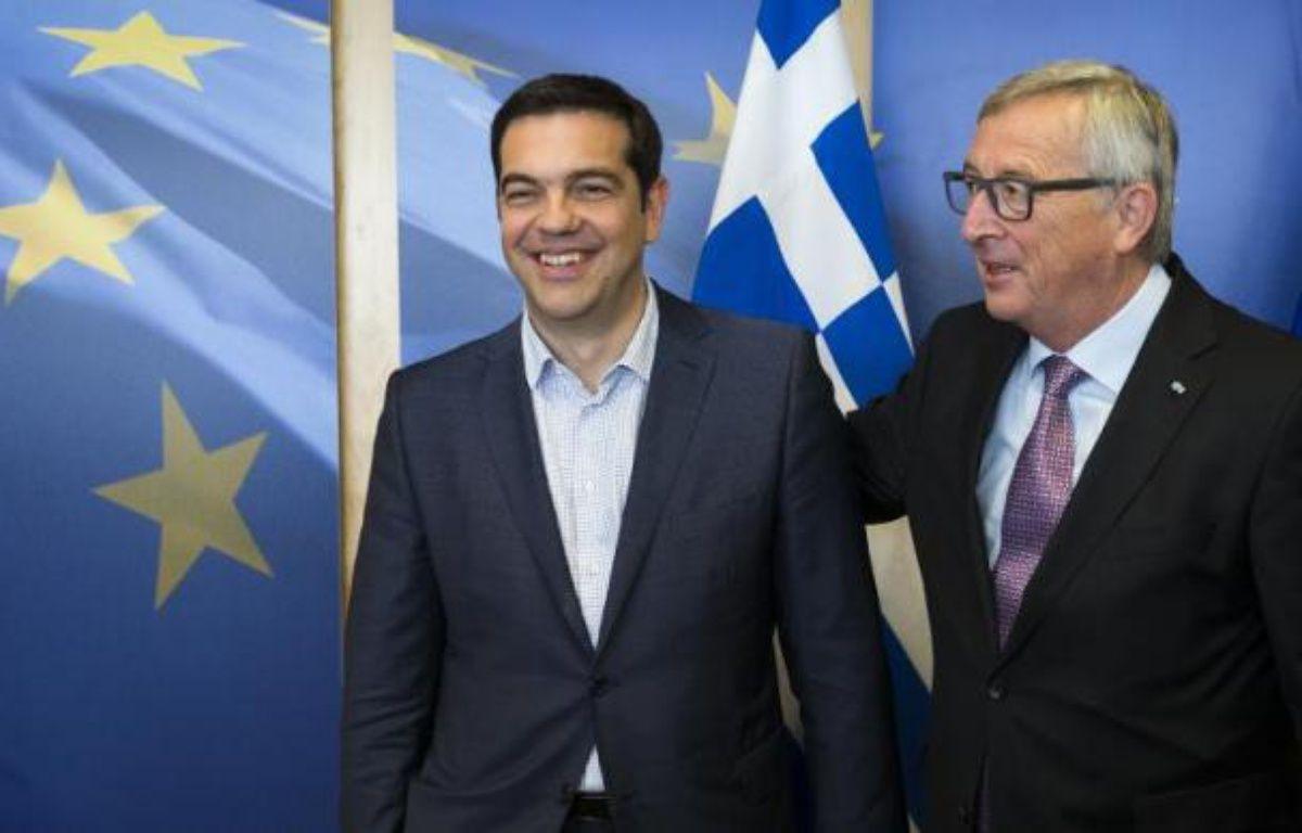 Le Premier ministre grec Alexis Tsipras et le président de la Commission européenne Jean-Claude Juncker à Bruxelles le 24 juin 2015 – JULIEN WARNAND POOL
