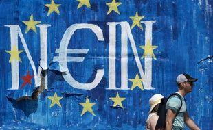 Un graffiti dans les rues d'Athènes signifiant