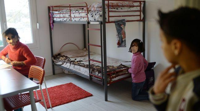 Des enfants d'une famille irakienne réfugiée dans leur logement à Bessancourt (Val-d'Oise), le 2 janvier 2016. – JEROME MARS/JDD/SIPA