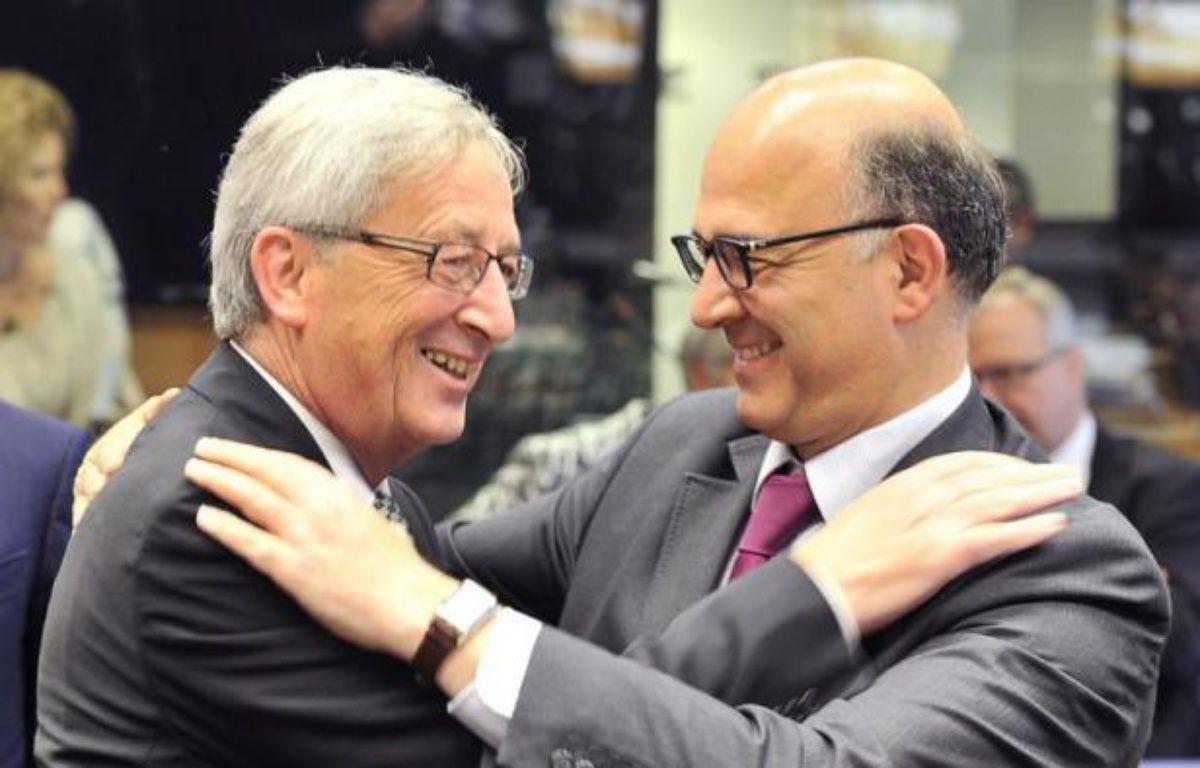 """La troïka des bailleurs de fond de la Grèce se rendra à Athènes dès lundi afin """"d'actualiser"""" le programme de réformes et de rigueur du pays, a annoncé jeudi soir le président de l'Eurogroupe Jean-Claude Juncker. – Georges Gobet afp.com"""