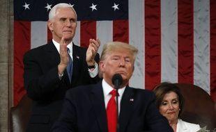 Le vice-président américaine Mike Pence, Donald Trump et la Speaker de la Chambre Nancy Pelosi le 4 février 2020.