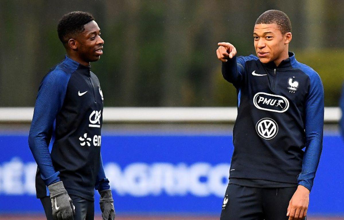 Ousmane Dembélé et Kylian Mbappé à l'entraînement avec l'équipe de France, le 23 mars 2017 à Clairefontaine.  – FRANCK FIFE / AFP