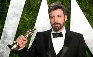 """Les médias iraniens ont qualifié lundi de """"politique"""" l'attribution de l'Oscar du meilleur film à """"Argo"""", le long-métrage de Ben Affleck qui porte sur la crise des otages américains de 1979, critiquant l'apparition pour l'annoncer de la Première dame Michelle Obama."""