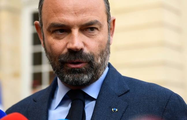 French Prime Minister Edouard Philippe speaks to the press upon his arrival at the Matignon hotel in Paris to take part in a government seminar following the