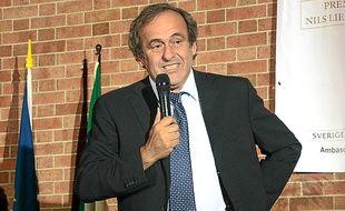 """Le président de l'UEFA, ici en Italie, trouve le public français """" très sévère""""."""