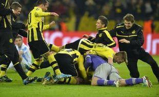 Dortmund, grâce à deux buts de Reus et Santana dans le temps additionnel, a arraché son billet pour le carré final de la Ligue des champions en battant 3-2 Malaga en quart retour (0-0 à l'aller), mardi à l'Iduna Park.
