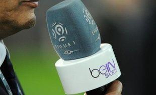 Un reporter de la chaîne BeIN Sports, pendant un match de Ligue 1, en mars 2014