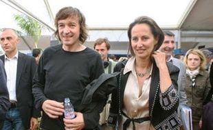 Le chanteur Cali et Ségolène Royal dans les travées du festival des Francofolies de La Rochelle.