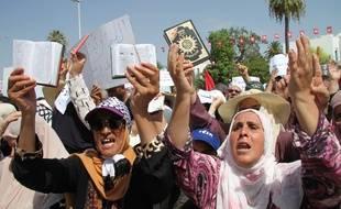 Des milliers de Tunisiens manifestent contre une réforme concernant notamment l'égalité hommes-femmes et la dépénalisation de l'homosexualité, à Tunis le 11 août 2018.